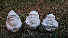 Drei kleine runde Weihnachtsmänner