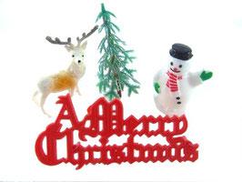 Décorations : bonhomme de neige, sapin, renne, inscription.