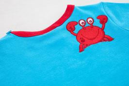 Bauchrutschpulli in blau/rot