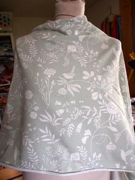 Des motifs fleuris sur du vert pâle sur ce jersey coton (modèle MC)