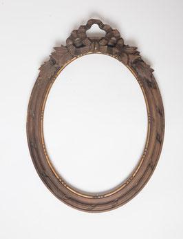 Cadre ovale en bois sculpté