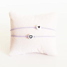 Vriendschapsbandjes 2x Lila elastiek + Witte kraal met zwart hartje