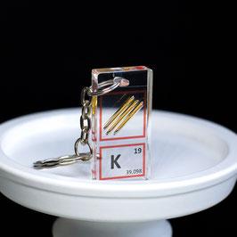 Potassium metal keychain
