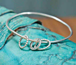 Lyric bangle with Three Textured Hoops