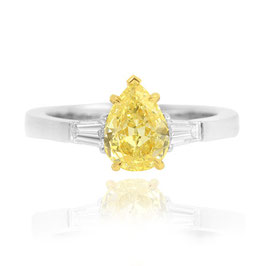 1.03 Carat, Fancy 1.03 Yellow Pear and Taper Diamond Three Stone Ring set in 18K gold, Pear, VS1