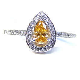 0.27 Carat, 0.27ct GIA Fancy Vivid Yellow Orange Diamond Ring set with a total of 41 stones, Pear