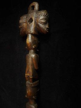 A Yoruba LARGE spoon Nigeria, with a seated female figure finial, 55.5cm long