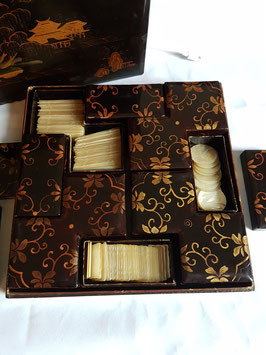 A Lacquer games box Qing Dynasty, Mother of Pearl Gaming Counters, Armorial COUNTERS