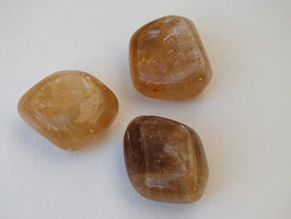 Calcite miel en pierres roulées