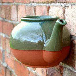 Die Teekanne für die Wand