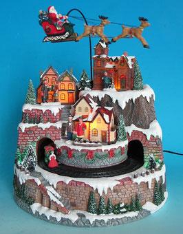Winterszene Dorf mit Zug und fliegendem Nikolaus
