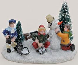 Miniatur Kinder mit Schneemann