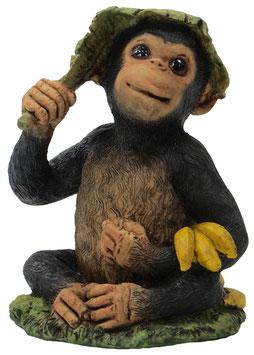 Schimpanse mit Bananen und Hut