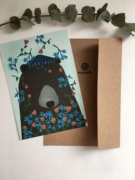Mini-Illustration Bär mit Blumenstrauß.