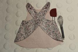 Tablier en coton enduit à fleurs garanti SANS PHTALATES (obligatoire pour les enfants de moins de 36 mois) Taille 2/3 ans. Pour exprimer mes talents de cuisinière ou de peintre.