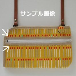 ◆正面ファスナーの上下を縁取りするデザイン