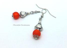Boucles d'oreilles argentées MOANA et sa perle polaris orange...