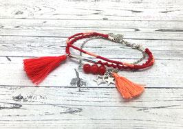 Bracelet argenté LOLITA et ses pompons dans les tons de rouge et corail...