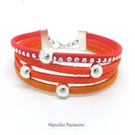 Bracelet 4 liens perles éparpillées dans les tons oranges...