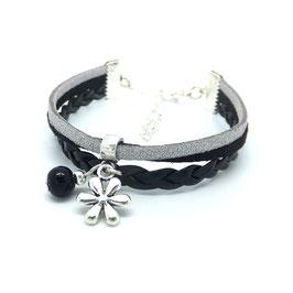 Bracelet manchette FLEUR dans les tons noirs, gris et argentés..