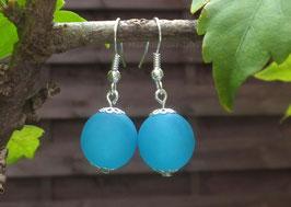 Simplissimes boucles d'oreilles perles polaris turquoises....