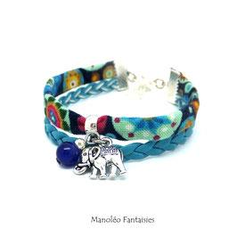 Bracelet manchette éléphant, dans les tons bleus et argentés...