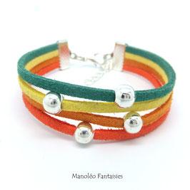 Bracelet 4 liens perles éparpillées dans les tons de verts et orangés...