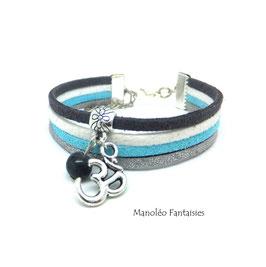 Bracelet Om̐ 4 liens et sa perle grise dans les tons de gris et turquoise...