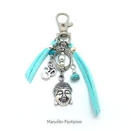 Bijou de sac ou porte-clés BOUDDHA dans les tons turquoises et argentés
