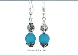 """Boucles d'oreilles argentées """"TOURBILLON"""" et sa perle polaris turquoise..."""