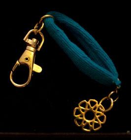 """Porte clefs avec bracelet et médaille """" mandalah"""" en métal"""