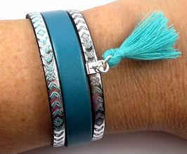 Bracelet en argent et cuir turquoise nacré et métallisé à motifs, pompon
