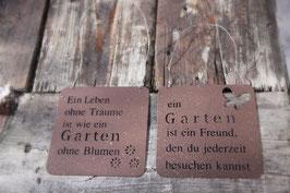 """Metallschild im Rost-Look mit der Aufschrift: """"Ein Leben ohne Träume ist wie ein Garten ohne Blumen"""""""