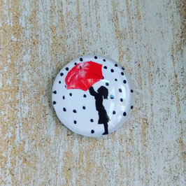 Kind unter Regenschirm