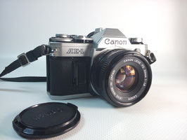 CANON : AE-1 + 50 mm f:/1.8 + Flash Sunpak [VENDU]