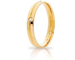 Fede Nuziale Unoaerre Lyra in Oro Giallo con diamante 34AFC289/001