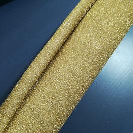 Feltro in lana modellabile doppiato con maglina glitter oro