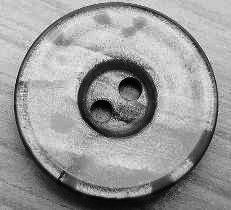 Knopf 2 Loch grau marmoriert 22mm kgr5