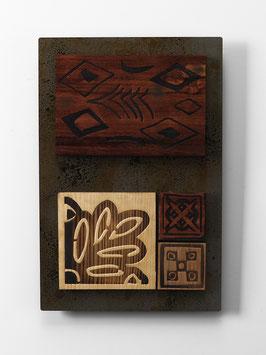 Calis. Quadro etnico. Composizione in metallo e legno. Tavolette magnetiche componibili.