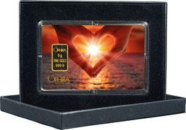 Herz aus zwei Händen mit einem Goldbarren ab 0,50 Gramm M1G1