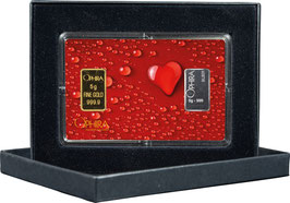 Herz aus Wassertropfen mit einem Gold- und einem Silberbarren M2GS