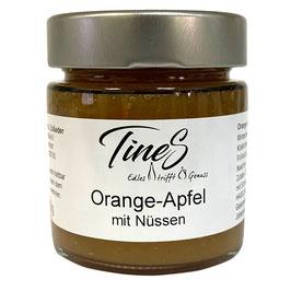 Orange-Apfel mit Nüssen