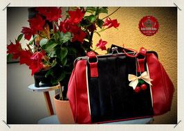 Damen Kisslock Streifen Stepp Handtasche