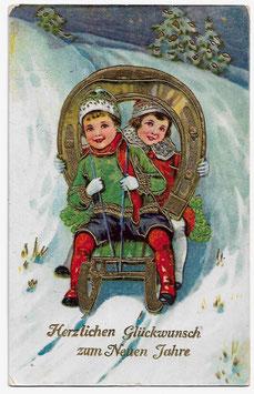 """Alte Postkarte """"HERZLICHEN GLÜCKWUNSCH ZUM NEUEN JAHRE""""  Kinder mit goldenem Hufeisen machen eine Schlittenfahrt, 1929"""