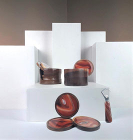 Set of two Brazilian onyx and palisander cocktail coasters and a bar-blade, 1960s