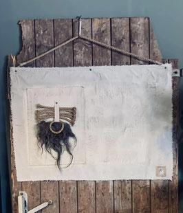 Lichtgrijs kalkdoek met touw en wol