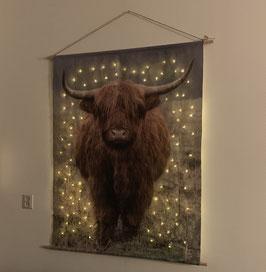wandversiering met kerstverlichting Schotse hooglander