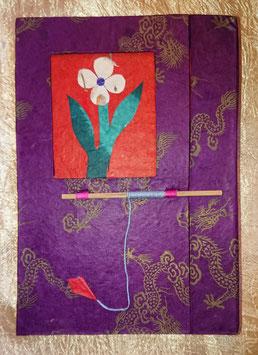 Bloc note violet avec fleur