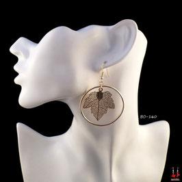 Boucles d'oreilles pendantes créoles dorées avec feuilles