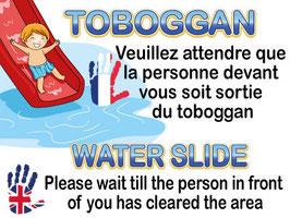 Panneau toboggan un à la fois en deux langues